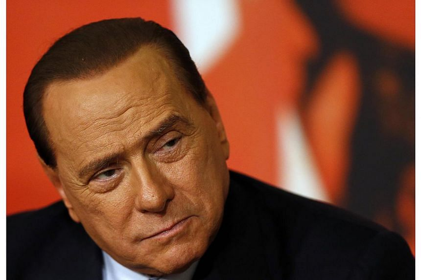 Italy's former prime minister Silvio Berlusconi attends a news conference in Rome, on Nov 25, 2013. The former Italian prime minister is being investigated for tampering with witnesses in a trial that saw him sentenced to jail for having sex with an
