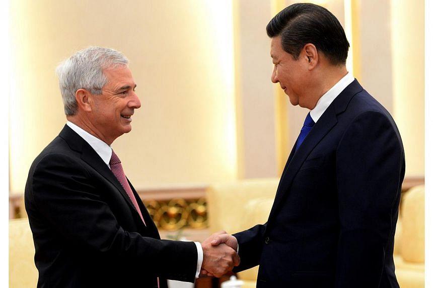 Chinese President Xi Jinping (right) shakes hands with Claude Bartolone, President of the French National Assembly, prior to a meeting at the Great Hall of the People in Beijing, on Jan 23, 2014. China's President Xi Jinping heralded the establishmen