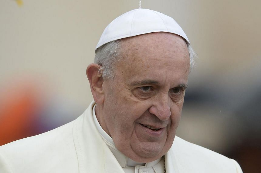 """Pope Francis looks on during his general audience at St Peter's square at the Vatican on Jan 22, 2014. Pope Francis described the Internet on Thursday as """"a gift from God"""" and called on Catholics to """"boldly become citizens of the digital world"""". -- P"""