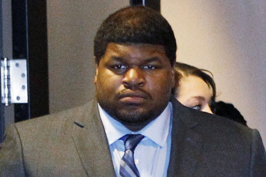 Former Dallas Cowboys player Josh Brent enters the courtroom in Dallas, Texas in this file photo taken on Jan 14, 2014. A Texas jury found former Dallas Cowboys player Josh Brent guilty on Wednesday of intoxication manslaughter in the car crash
