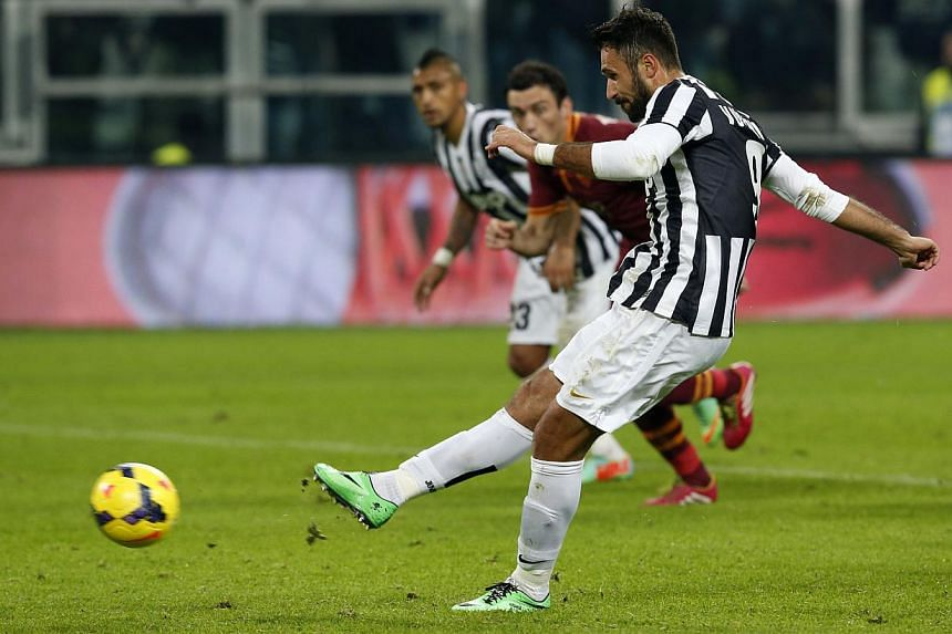 Juventus' Mirko Vucinic scores a penalty against AS Roma during their Italian Serie A soccer match at the Juventus stadium in Turin on Jan 5, 2014. Juventus reacted angrily and accused Inter Milan of lacking respect on Wednesday after an agreeme