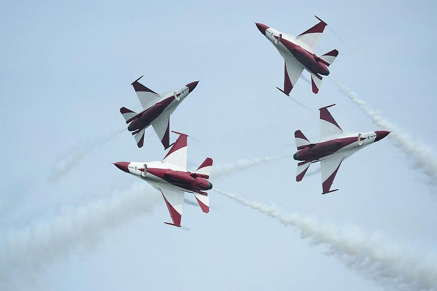 The Republic of Singapore Air Force (RSAF) aerobatics team, the Black Knights, perform a criss cross (new manoeuvre) during the media preview aerial display, on Jan 21, 2014. From a slow, measured glide to heart-stopping nosedives, spectators at this