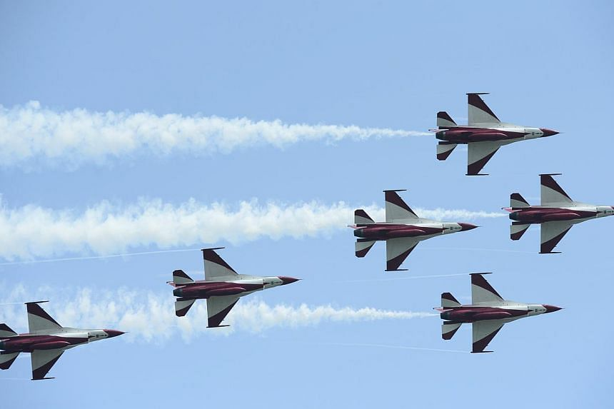 The Republic of Singapore Air Force (RSAF) aerobatics team, the Black Knights, flyby in a spear formation (new manoeuvre) during the media preview aerial display, on Jan 21, 2014. -- ST PHOTO: MARK CHEONG