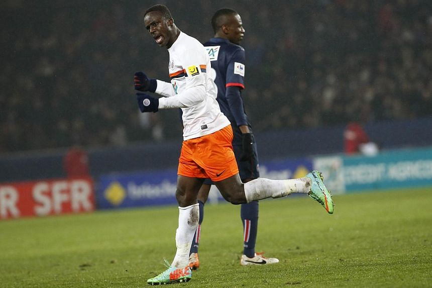 Montpellier's Columbian forward Victor Hugo Montano celebrates after scoring during the French Cup football match between Paris Saint-Germain(PSG) and Montpellier (MHSC) on Jan 22, 2014 at the Parc des Princes stadium, in Paris. Paris Saint-Germain (
