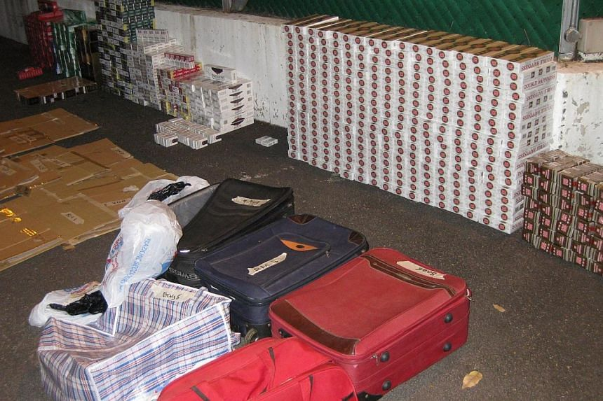 Contraband cigarettes stored in luggages, recovered in one of the operations.-- PHOTO: SINGAPORE CUSTOMS