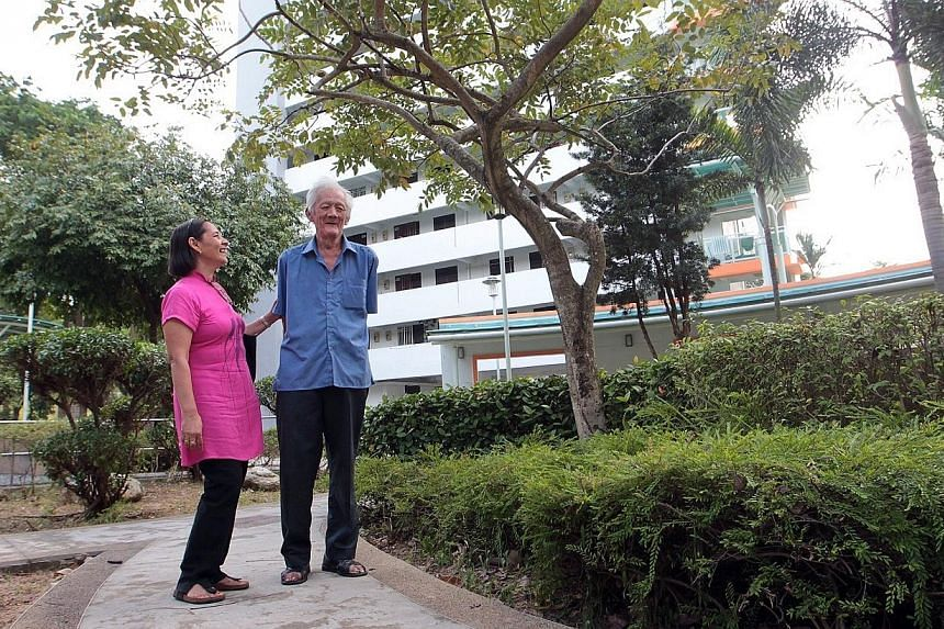 Mr Tan Tock Hwee (in blue), 66, takes a walk at a park near his block with his befriender, Madam Sharifah. Apioneering project called Neighbours for Active Living, spearheaded by the South East Community Development Council, aims to get the com