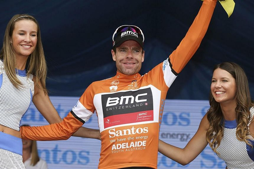 Cadel Evans from Australia gestures on the podium after winning stage 3 of the 2014 Tour Down Under cycling race near Adelaide on Jan 22, 2014.Former Tour de France winner Cadel Evans seized control of the Tour Down Under with a dominant win in