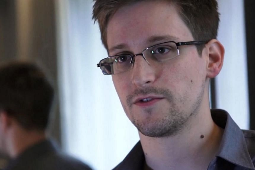 This still frame grab recorded on June 6, 2013, shows Edward Snowden speaking during an interview with The Guardian newspaper at an undisclosed location in Hong Kong. The Justice Department has accused United States Investigations Services (USIS), th