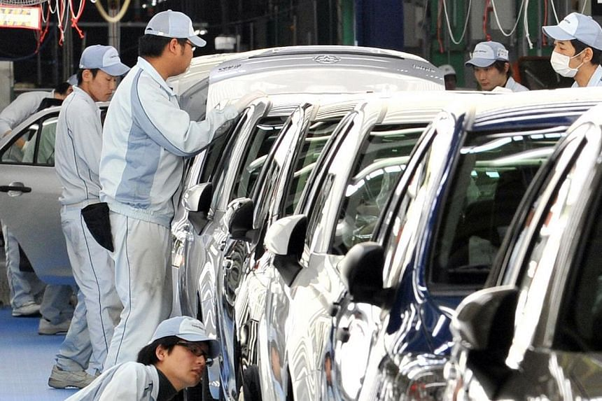 """Toyota workers checking paints and bodies of Toyota Motor's best selling car """"Corolla"""" at Toyota Motor East Japan's Ohira at Ohira village in Miyagi prefecture, northern Japan on May 11, 2012Toyota sold a record 9.98 million vehicles last year,"""
