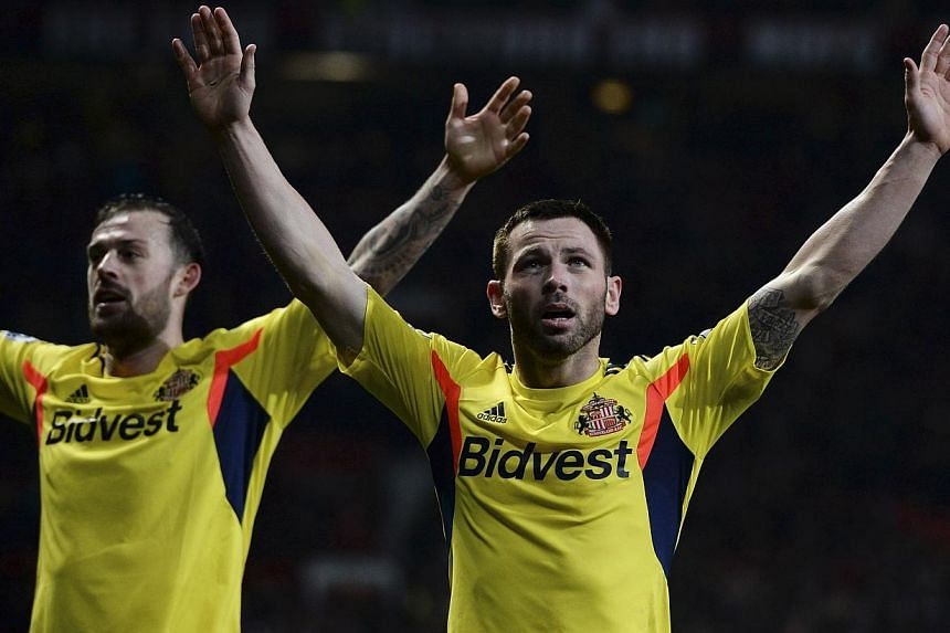 Sunderland's Phil Bardsley (right) celebrates after scoring against Manchester United during their English League Cup semi-final second leg soccer match at Old Trafford in Manchester, northern England on Jan 22, 2014. Manchester United's desperate se