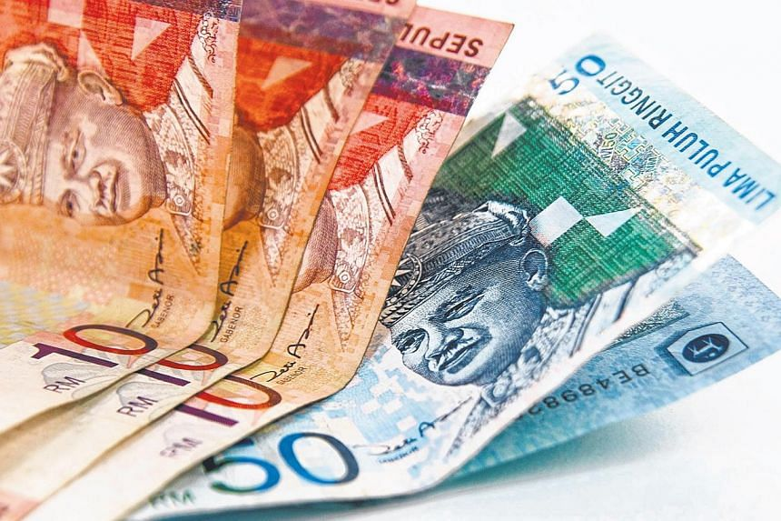 The Singapore dollar has risen strongly against the Malaysian ringgit to a four-month high, in a boon for locals travelling or shopping across the Causeway. -- PHOTO: BLOOMBERG