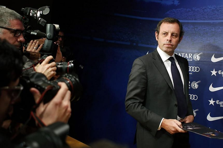 Barcelona president Sandro Rosell arrives for a news conference where he announced his resignation, at Camp Nou stadium in Barcelona on Jan 23, 2014. Rosell, facing legal action over the signing of Brazil star Neymar, resigned after a three-and-