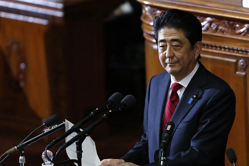 "Japan's Prime Minister Shinzo Abe makes a policy speech in Tokyo, on Friday, Jan 24, 2014. Mr Abe said on Friday that Japan and China are ""inseparable"" and urged Beijing to come to the table for ""vital"" summit talks as he sought to move on from compa"