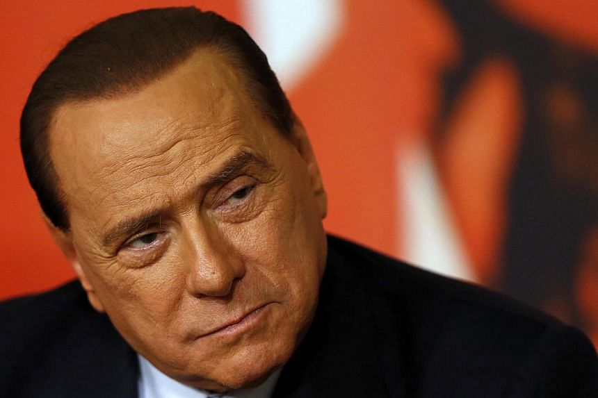 Italy's former prime minister Silvio Berlusconi attends a news conference in Rome, on Nov 25, 2013. Berlusconi has cut off monthly payments of 2,500 euros (S$4,370) to a host of young women who attended his parties as part of cost-cutting measures by