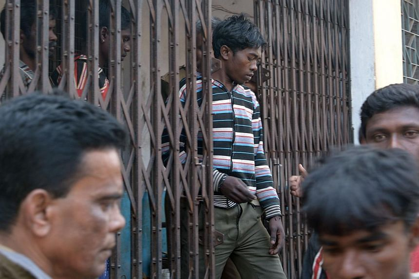 """Suspects in a gang-rape case are led by police to a district courthouse in Bolpur of Birdhum district, some 240km north-west of Kolkata, on Jan 24, 2014. Thirteen men arrested over the alleged gang-rape of a woman in India for """"dishonouring"""" her comm"""