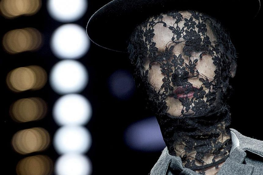 A model shows a creation from the collection of designer Aziz Bekkaoui on the catwalk during the opening of the Amsterdam Fashion Week in Amsterdam, on Jan 23 2014. -- PHOTO: AFP