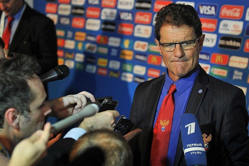 Russia's coach Fabio Capello speaks to the press after the Brazil 2014 FIFA World Cup groups-stage draw, in Costa do Sauipe, Bahia state, Brazil, on Dec 6, 2013. Russia's Football Union (RFU) said on Friday that it has extended its contract with
