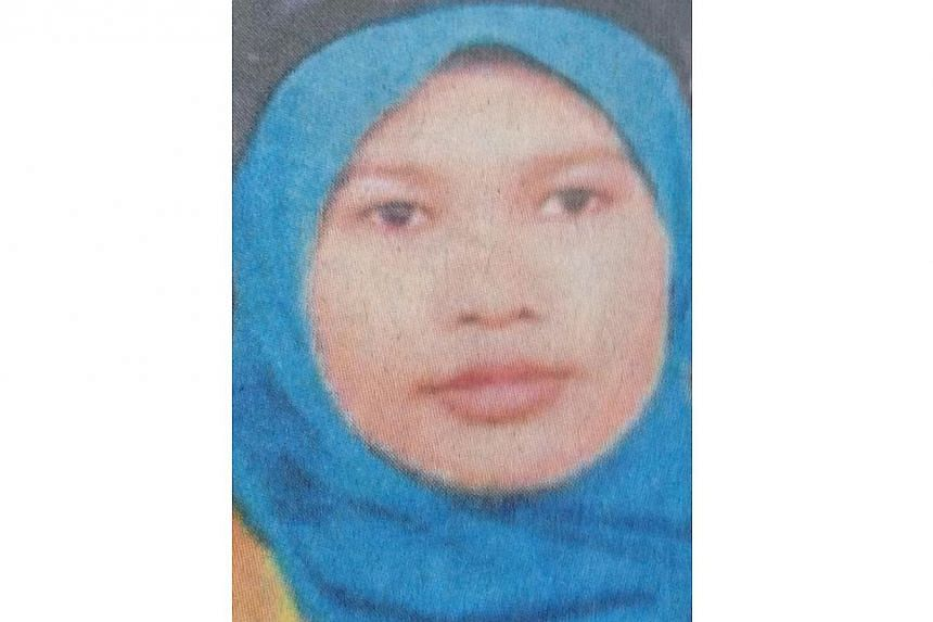The 28-year-old Malaysian school teacher, Nurul Ruhana Ishak, charged with criminal trespass in Singapore has a long history of mental illness, said  a relative. -- PHOTO: THE STAR