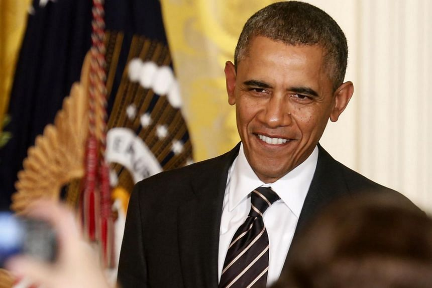 US President Barack Obama smiles as he arrives to deliver remarks at a reception with US mayors at the White House in Washington on Jan 23, 2014. Mr Obama urged South Sudan's government and rebels Thursday to implement a new ceasefire as soon as poss