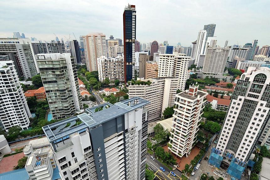 Private home prices fell by 0.9 per cent in the last three months of last year, a slightly faster pace than previously estimated, the Urban Redevelopment Authority (URA) said on Friday. -- ST FILE PHOTO:ALPHONSUS CHERN