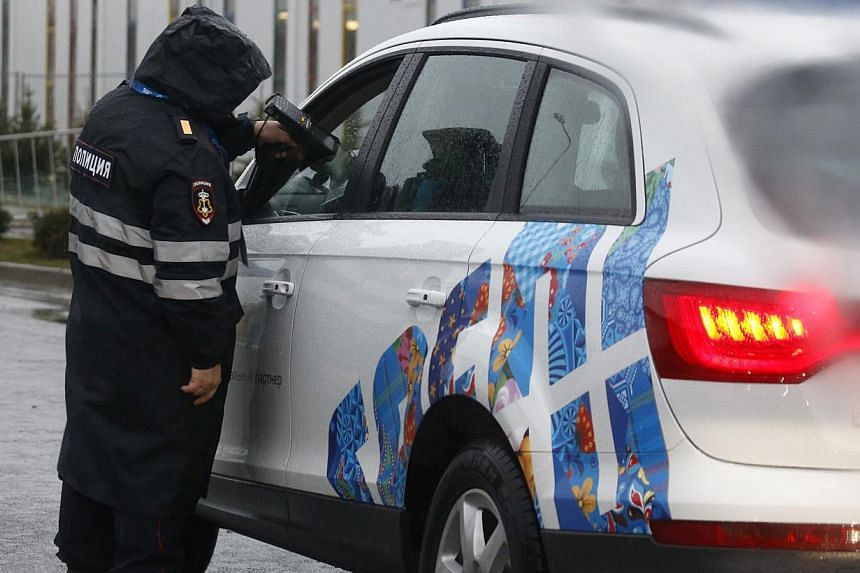 A Russian police officer checks a driver's documents at the Olympic Park in the Adler district of Sochi, on Jan 23, 2014. Russia is not cooperating enough in sharing intelligence with the United States about possible threats by militants to atta