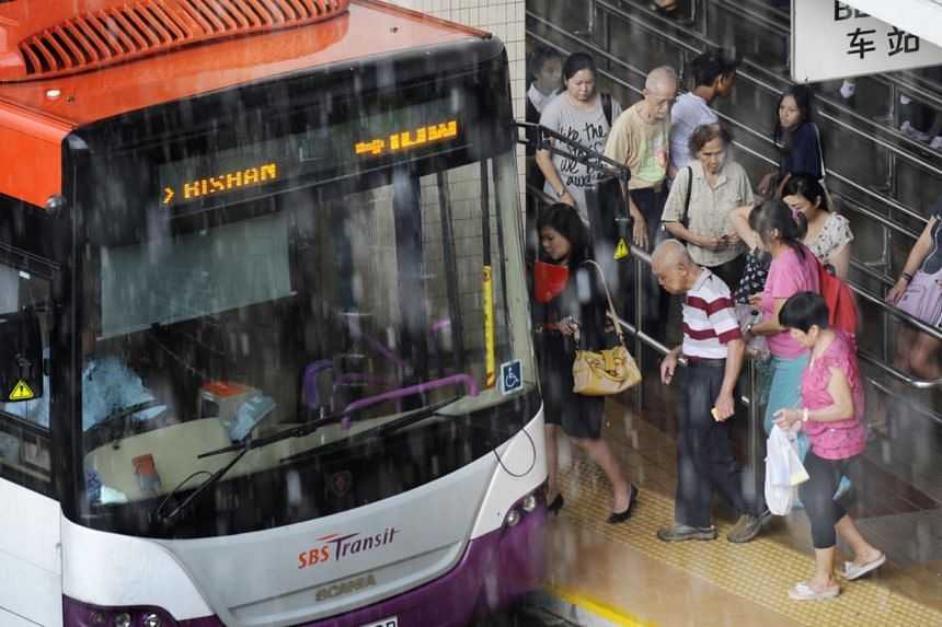 Passengers boarding a bus at Bishan bus interchange on Aug 3, 2012. Commuters on 22 bus services can expect buses to arrive more regularly when a carrot-and-stick scheme for operators kicks off next month. -- ST FILE PHOTO:ASHLEIGH SIM&nb