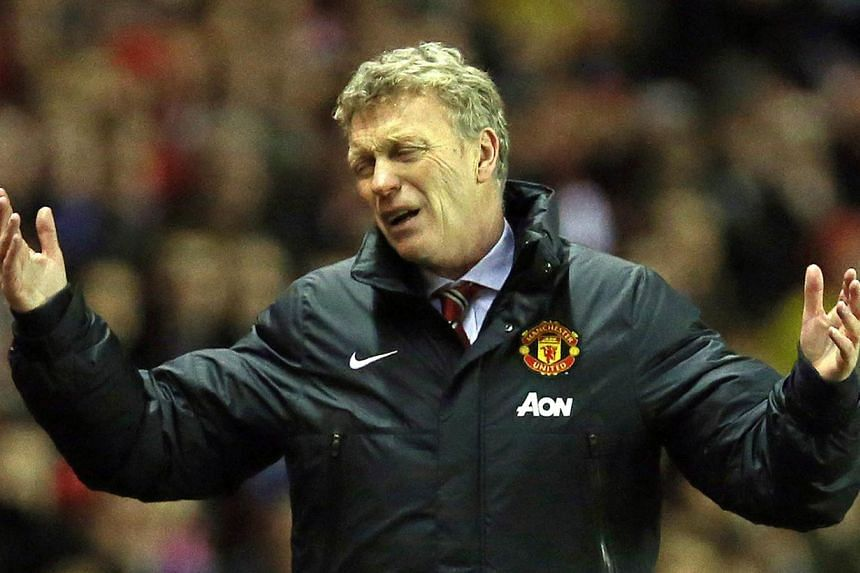 Manchester United's Scottish manager David Moyes reacts during a League Cup semi-final first leg match between Sunderland and Manchester United at the Stadium of Light in Sunderland, in north-east England, on Jan 7, 2014. -- FILE PHOTO: AFP