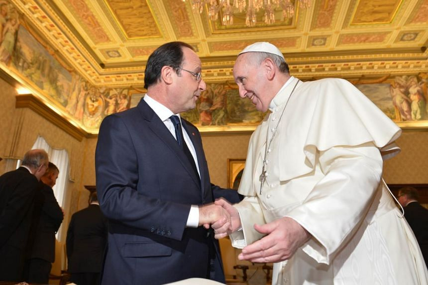 France's President Francois Hollande (left) meets with Pope Francis during a private audience on Jan 24, 2014, at the Vatican. -- PHOTO: AFP