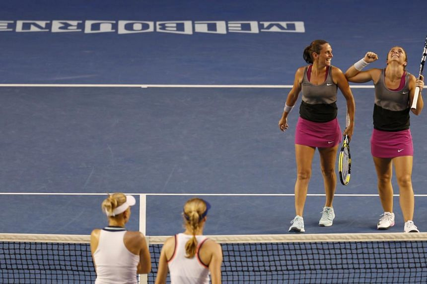 Sara Errani of Italy (right) and Roberta Vinci of Italy celebrate defeating Ekaterina Makarova of Russia and Elena Vesnina of Russia in their women's doubles final match at the Australian Open 2014 tennis tournament in Melbourne Jan 24, 2014. -- PHOT