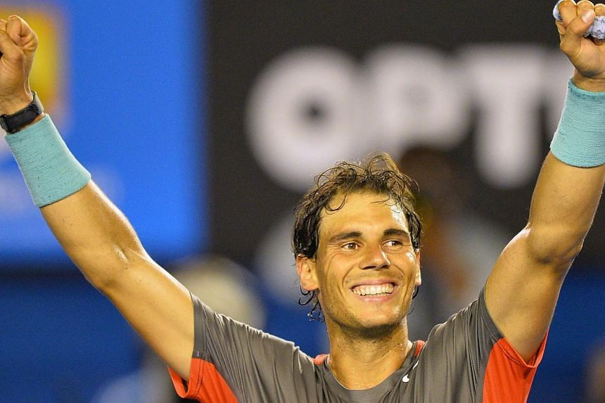 Spain's Rafael Nadal celebrates his victory against Switzerland's Roger Federer during their men's singles semi-final match on day 12 of the 2014 Australian Open tennis tournament in Melbourne, on Jan 24, 2014. -- PHOTO: AFP