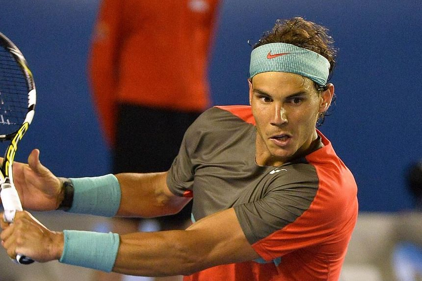 Rafael Nadal of Spain hits a return against Roger Federer of Switzerland during their men's singles semi-final match on day 12 of the 2014 Australian Open tennis tournament in Melbourne, on Jan 24, 2014. -- PHOTO: AFP
