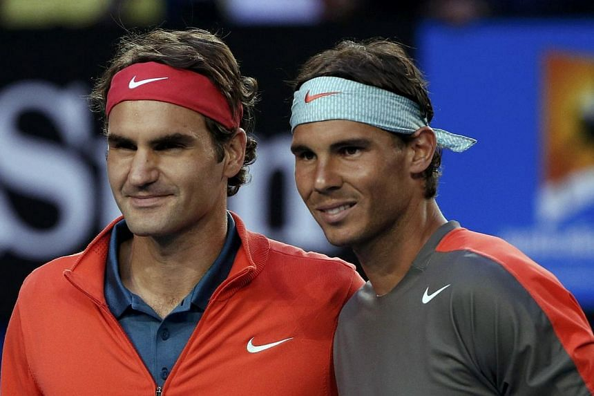 Roger Federer of Switzerland poses for a photo with Rafael Nadal of Spain before their men's singles semi-final match at the Australian Open 2014 tennis tournament in Melbourne, on Jan 24, 2014. -- PHOTO: REUTERS