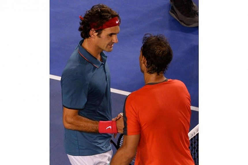 Spain's Rafael Nadal (R) shakes hands with Switzerland's Roger Federer after winning their men's singles semi-final match on day 12 of the 2014 Australian Open tennis tournament in Melbourne, on Jan 24, 2014. -- PHOTO: REUTERS
