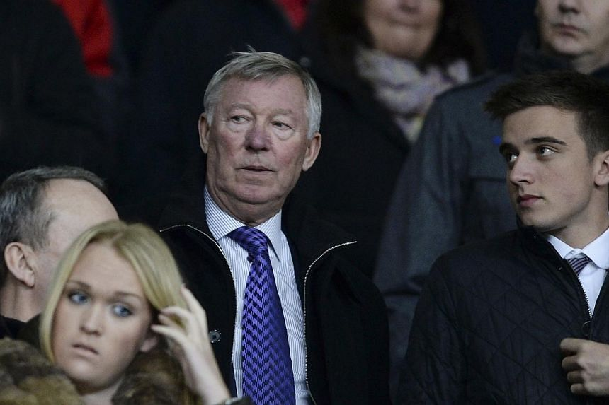 Manchester United's former manager Alex Ferguson at the English League Cup semi-final second leg match between United and Sunderland at Old Trafford in Manchester, northern England, on Jan 22, 2014. Ferguson is set to take up a role with European foo