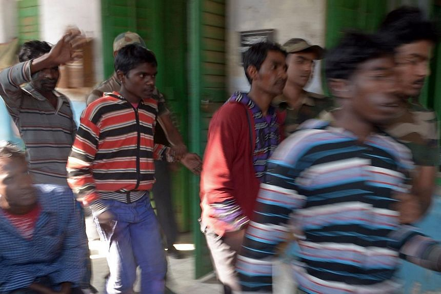 Suspects in a gang-rape case are led by police to a district courthouse in Bolpur of Birdhum district, some 240km north-west of Kolkata, on Friday, Jan 24, 2014.Male residents fled an Indian village on Friday after the alleged gang-rape of a yo