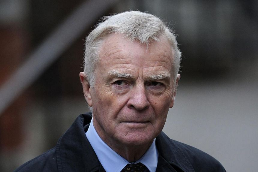 Former F1 chief Max Mosley arrives to attend the Leveson Inquiry in central London, on Nov 21, 2011. A German court ruled on Friday, Jan 24, 2014, that Google must block photos of a sadomasochistic orgy involving former Formula One boss Max Mosl
