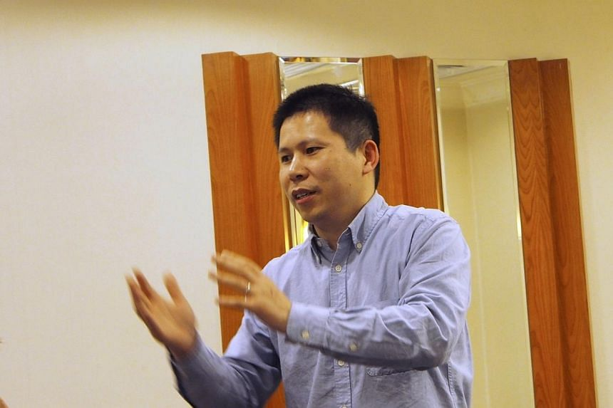 Chinese rights advocate Xu Zhiyong speaks during a meeting in Beijing, in this handout photo dated on March 30, 2013.A Beijing court will sentence prominent Chinese rights activist Xu Zhiyong on Sunday, Jan 26, 2014, in the highest-profil