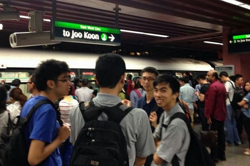 A train stalled at Redhill MRT station on Friday night, forcing hundreds of passengers to disembark. -- PHOTO: SARAH AU-YONG