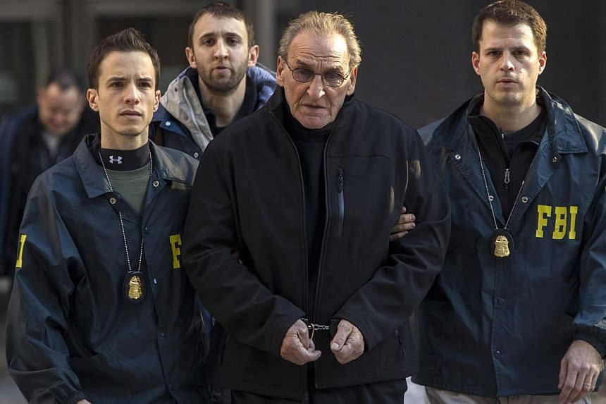 Bonanno crime family leader Vincent Asaro is escorted by FBI agents from their Manhattan offices in New York on Jan 23, 2014.Asarowas arrested on Thursday over the spectacular 1978 cash and jewelry heist from JFK airport immortalized in M