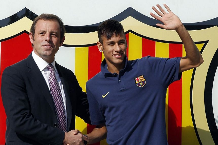 File picture taken in June shows FC Barcelona's new player Brazilian Neymar da Silva Santos Junior posing with Barcelona's former President Sandro Rosell at Camp Nou stadium in Barcelona. --PHOTO: AFP
