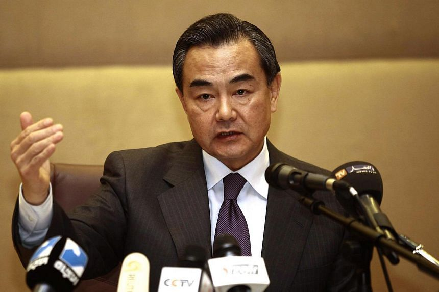 China's Foreign Minister Wang Yi speaks to members of the media during a news conference in Algiers last year. -- PHOTO:REUTERS