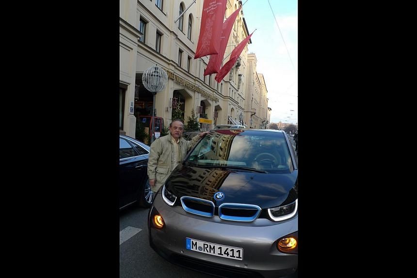 Mr Yap Pow Look with the BMW i3 premium electric car that he test-drove in Munich last year. -- PHOTO: COURTESY OF YAP POW LOOK