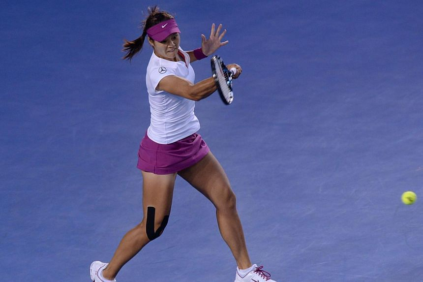 China's Li Na plays a shot during her women's singles final match against Slovakia's Dominika Cibulkova on day thirteen of the 2014 Australian Open tennis tournament in Melbourne, on Jan 25, 2014. -- PHOTO: AFP