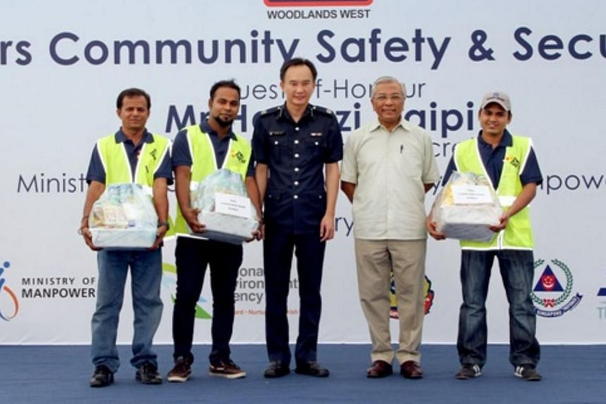 Mr Hawazi Daipi, Senior Parliamentary Secretary for the Ministry of Manpower and Education,with the winners of the Cleanest and Safest Room Competition. -- PHOTO: SINGAPORE POLICE FORCE