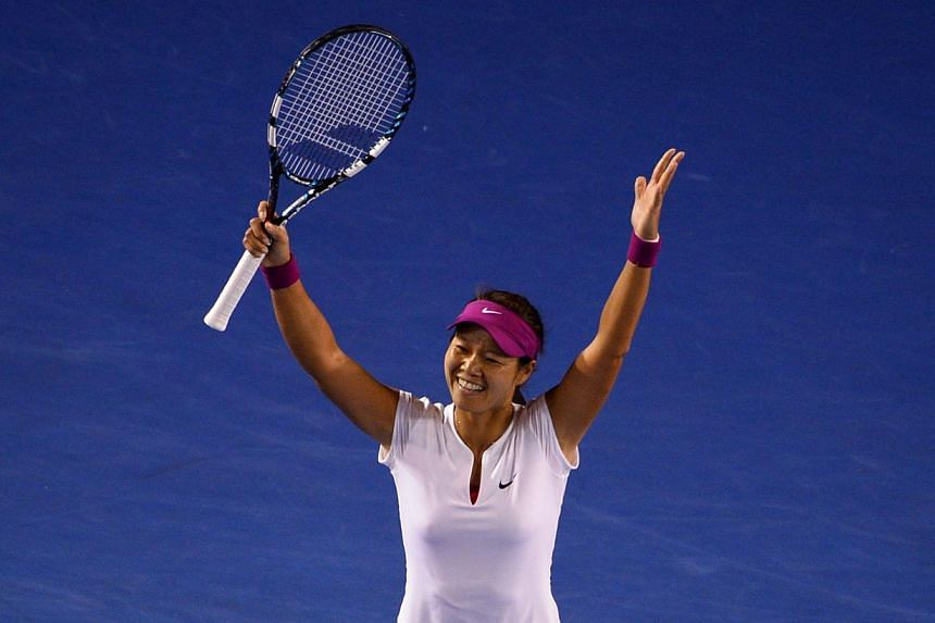 Li Na of China celebrates winning her women's singles final against Dominika Cibulkova of Slovakia during on day 13 of the 2014 Australian Open tennis tournament in Melbourne, on Jan 25, 2014.  -- PHOTO: AFP