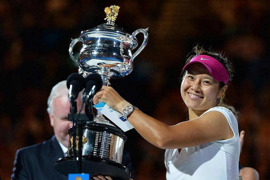 China's Li Na poses with the trophy after her victory against Slovakia's Dominika Cibulkova during the women's singles final of the 2014 Australian Open tennis tournament in Melbourne, on Jan 25, 2014. Li stormed to her second Grand Slam title on Sat