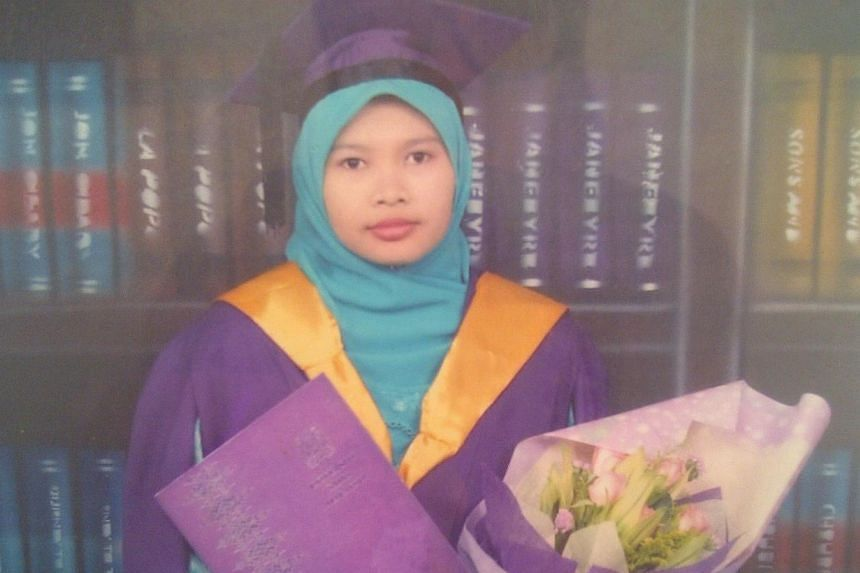 Family members of Malaysian school teacher Nurul Ruhana Ishak (pictured), who is remanded for psychiatric assessment after she was charged with criminal trespass, visited her at the Institute of Mental Health (IMH) on Saturday afternoon. -- PHO