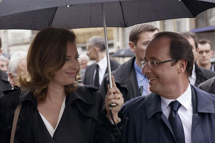 French President Francois Hollande (right), seen in this June 9, 2012, file photo, is expected to announce his separation from partner Valerie Trierweiler (left) on Saturday, Jan 25, 2014, following a media storm over allegations he is having an affa