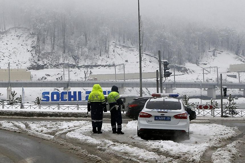 Russian traffic police stand guard during patrols on a road to Krasnya Polyana, near Sochi, on Jan 24, 2014. The United States (US) Olympic Committee has advised athletes taking part in the upcoming Sochi Games to avoid wearing their uniforms or