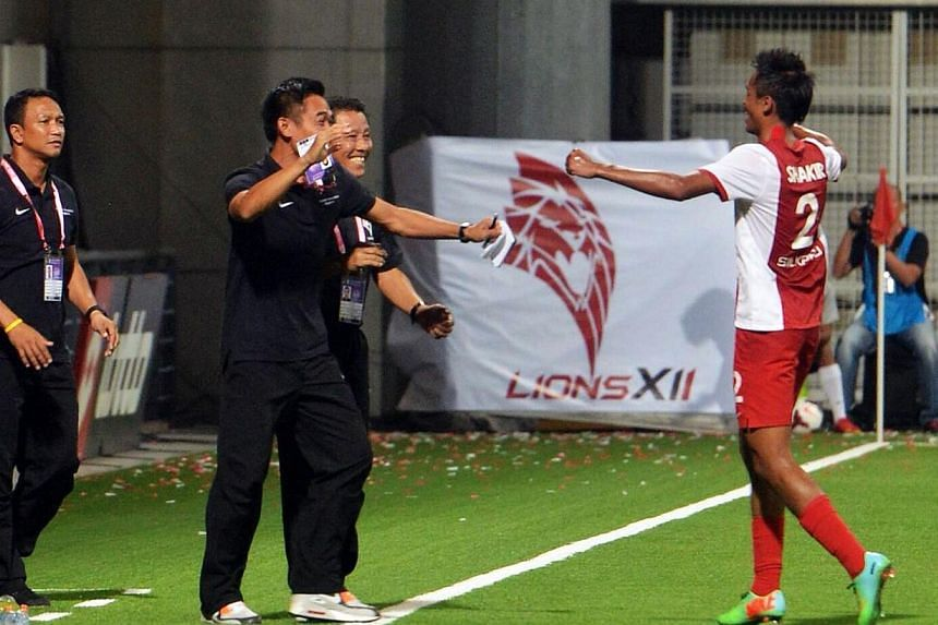 LionsXII left-back Shakir Hamzah celebrates scoring his side's first goal against Selangor. Khairul Amri's dramatic stoppage-time winner handed the LionsXII a 2-1 win over their arch-rivals on Saturday, in coach Fandi Ahmad's Malaysian Super Lea